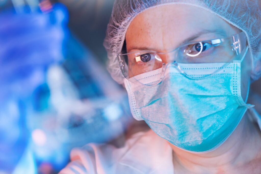 Scientist working with chemicals in laboratory